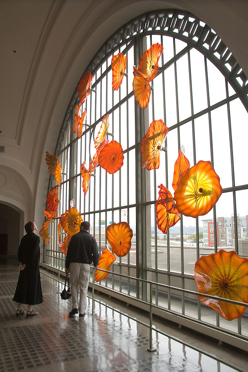 Couple looking at Monarch Window of glass art by Dale Chihuly, Union Station, Tacoma, Washington, USA