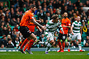 Celtic FC Midfielder Kris Commons getting tripped during the Ladbrokes Scottish Premiership match between Celtic and Dundee United at Celtic Park, Glasgow, Scotland on 25 October 2015. Photo by Craig McAllister.