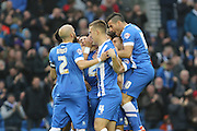 Brighton striker, Solomon March is surrounded by team mates after scoring the first goal during the Sky Bet Championship match between Brighton and Hove Albion and Milton Keynes Dons at the American Express Community Stadium, Brighton and Hove, England on 7 November 2015. Photo by Geoff Penn.