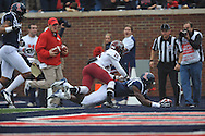 Mississippi's Laquon Treadwell (1) scores against Troy cornerback Chris Davis (25) at Vaught-Hemingway Stadium in Oxford, Miss. on Saturday, November 16, 2013. Ole Miss won 51-21.