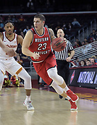 Western Kentucky Hilltoppers forward Justin Johnson (23) dribbles the ball against the Southern California Trojans during an NCAA college basketball game in the second round of the NIT tournament in Los Angeles, Monday, Mar 19, 2018. WKU defeated USC 79-75.