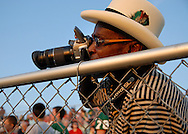 11 SEPT. 2009 -- ST. LOUIS -- Lindbergh fan Steve Hamm-Bey (CQ) photographs before the start of  the Flyers game against Oakville High School Friday, Sept. 11, 2009. Hamm-Bey's son Tim plays for Lindbergh. Photo © copyright 2009 by Sid Hastings.