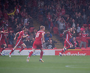 August 19th 2017, Pittodrie Stadium, Aberdeen, Scotland;  Scottish Premiership football, Aberdeen versus Dundee; Aberdeen's Stevie May celebrates in the Pittodrie rain after scoring for 1-0