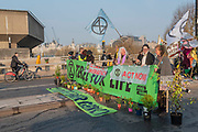 Already the banners of the road block are up and the police in place - Morning on Waterloo Bridge sees the camp awake and commuters make their progress on foot and bike across the river - Day 3 - Protestors from Extinction Rebellion block several junctions in London as part of their ongoing protest to demand action by the UK Government on the 'climate chrisis'. The action is part of an international co-ordinated protest.