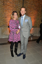 JAKE PARKINSON-SMITH and his wife SAMIRA PARKINSON-SMITH at the Future Contemporaries Party in association with Coach at The Serpentine Sackler Gallery, West Carriage Drive, Kensington Gardens, London on 21st February 2015.