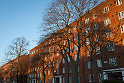 Blocks of flats in warm evening sunshine, on 7th March 2018, on Denmark Hill in the south London borough of Southwark.