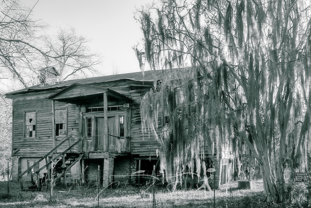 "The dilapidated remains of the Fambro Arthur home are pictured, Feb. 7, 2015, in Orrville, Alabama. The wooden frame cottage was built in the 1840's and was more typical of the average person's house in the antebellum era. Besides the slave quarters at Kirk-View mansion, the Fambro Arthur home is the only remaining structure on the grounds of Old Cahawba Archaeological Park. It is considered ""at risk"" by the Alabama Historical Commission, which is seeking funds to restore it. Cahaba, also known as ""Old Cahawba,"" was Alabama's state capital from 1819-1826 but was abandoned after the Civil War. It is now considered a ghost town. It is located in Dallas County near Selma, Alabama. (Photo by Carmen K. Sisson/Cloudybright)"