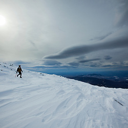 A photographer near the summit of Mount Washington in New Hampshire's White Mountains. Winter.
