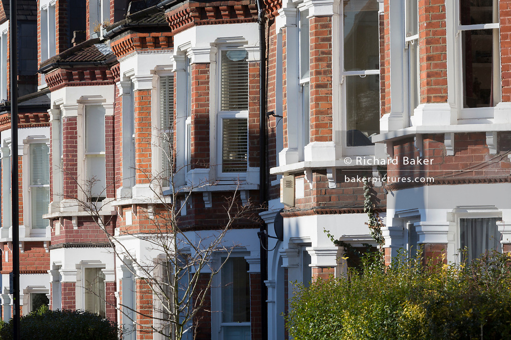 Terraced houses on a residential street in Herne Hill SE24, on 10th February 2019, in London, England.