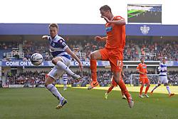 QPR's defender Clint Hill and Blackpool's midfielder Chris Basham compete for the ball - Photo mandatory by-line: Mitchell Gunn/JMP - Tel: Mobile: 07966 386802 29/03/2014 - SPORT - FOOTBALL - Loftus Road - London - Queens Park Rangers v Blackpool - Championship