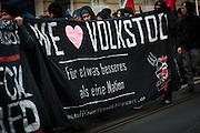 Frankfurt | 25 February 2017<br /> <br /> Am Samstag (25.02.2017) nahmen etwa 1000 Menschen in Frankfurt am Main an einer linksradikalen Demonstration unter dem Motto &quot;Make Racists Afraid Again&quot; Teil. Die Demo begann am S&uuml;dbahnhof in Frankfurt-Sachsenhausen und endete am Willy-Brandt-Platz. Organisiert wurde der Aufmarsch von dem B&uuml;ndnis &quot;Antifa United Frankfurt&quot;.<br /> Hier: Aktivisten mit einem Transparent mit der Aufschrift &quot;We Love Volkstod - F&uuml;r etwas besseres als eine Nation&quot;.<br /> <br /> photo &copy; peter-juelich.com