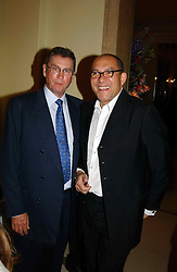 """Left to right, LORD ASHCROFT and BRUCE OLDFIELD at a party to celebrate the publication of Bruce Oldfield's autobiography """"Rootless"""" held in aid of Crimestoppers at Claridge's, Brook Street, London W1 on 22nd September 2004.<br /><br />NON EXCLUSIVE - WORLD RIGHTS"""
