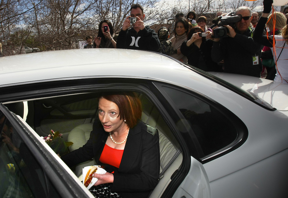 Federal Election 2010 - Prime Minister Julia Gillard with a hotdog she was given by a young boy after voting at Seabrook Primary School in Melbourne s western suburbs  - Pic By Craig Sillitoe 21/08/2010 SPECIAL 000 melbourne photographers, commercial photographers, industrial photographers, corporate photographer, architectural photographers, This photograph can be used for non commercial uses with attribution. Credit: Craig Sillitoe Photography / http://www.csillitoe.com<br /> <br /> It is protected under the Creative Commons Attribution-NonCommercial-ShareAlike 4.0 International License. To view a copy of this license, visit http://creativecommons.org/licenses/by-nc-sa/4.0/.