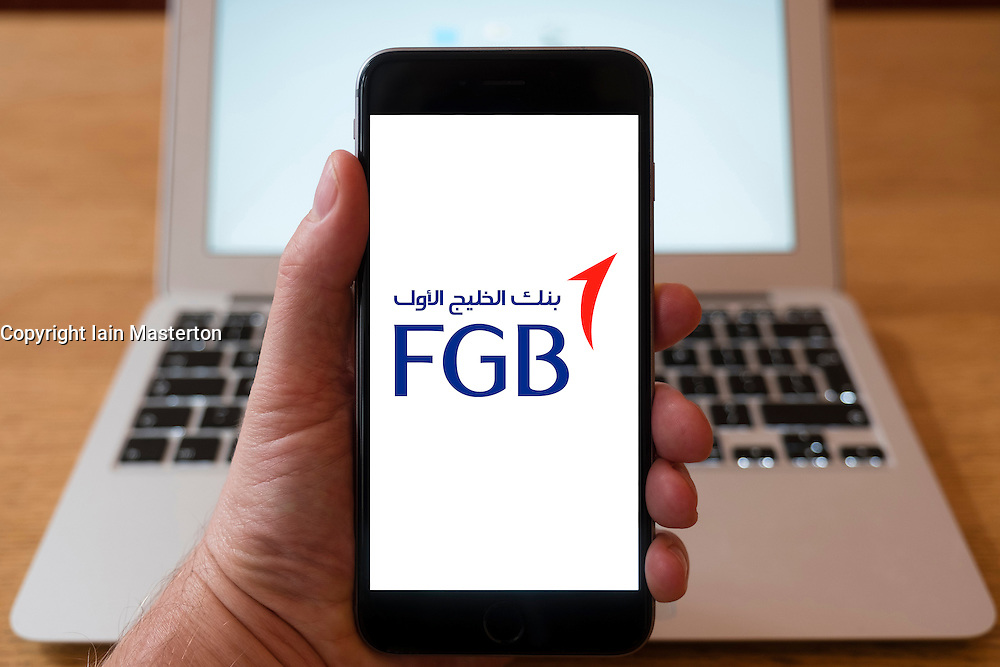 Using iPhone smart phone to display website logo of First Gulf Bank from the United Arab Emirates.