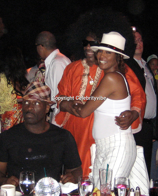 **EXCLUSIVE**.Stevie Wonder & Whitney Houston.Silly 70's Party with performances by Aerosmith, Earth Wind, Fire & Village People & Stevie Wonder.Opening of Cain at The Cove Hotel.Grand Ballroom.Atlantis Hotel.Paradise Island, Bahamas.Saturday, May 12, 2007 .Photo By Celebrityvibe.To license this image please call (212) 410 5354; or.Email: celebrityvibe@gmail.com ;.