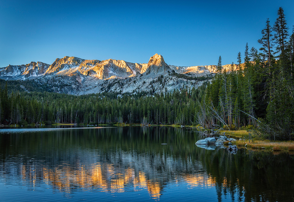 Sunrise on Crystal Crag and the Mammoth Crest from Lake Mamie; Mammoth Lakes Basin, eastern Sierra Nevada Mountains, California.