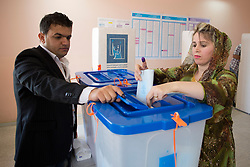 © Licensed to London News Pictures. 30/04/2014. Sulaimaniya, Iraq. A Kurdish Iraqi places her voting slip into a ballot box during the 2014 Iraqi parliamentary elections in Sulaimaniya, Iraqi-Kurdistan today (30/04/2014). . <br /> <br /> The period leading up to the elections, the fourth held since the 2003 coalition forces invasion, has already seen polling stations in central Iraq hit by suicide bombers causing at least 27 deaths. Photo credit: Matt Cetti-Roberts/LNP