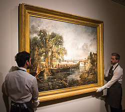 "Christie's, St James, London. Gallery technicians straighten the painting as Christie's in London announce the sale of a work of genius by John Constable, the full scale six-foot ""sketch"" for ""View on the Stour near Dedham"" painted between 1821 and 1822, which is expected to fetch between £18-22 million at auction."