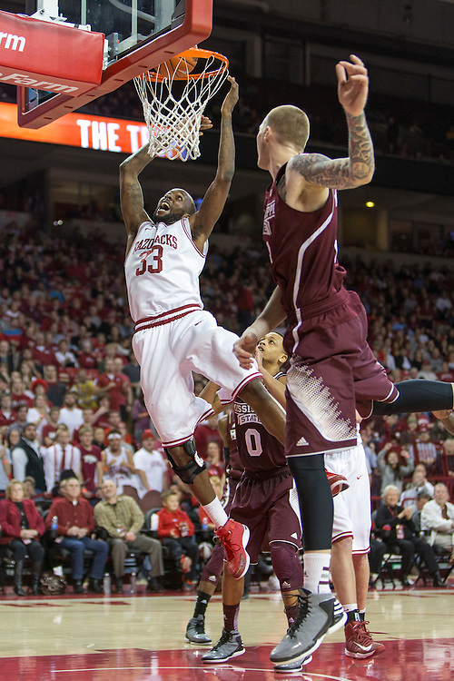 FAYETTEVILLE, AR - JANUARY 23:  Marshawn Powell #33 of the Arkansas Razorbacks goes up for a shot under the basket during a game against the Mississippi State Bulldogs at Bud Walton Arena on January 23, 2013 in Fayetteville, Arkansas. The Razorbacks defeated the Bulldogs 96-70.  (Photo by Wesley Hitt/Getty Images) *** Local Caption *** Marshawn Powell