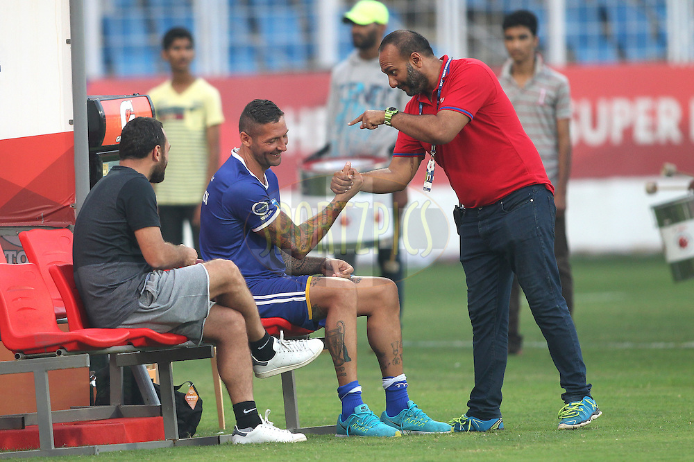 Chennaiyin FC coach Marco Materazzi chats to Bkran of ISL during the pre-final practice session by Chennaiyin FC held at the Jawaharlal Nehru Stadium, Fatorda, Goa, India on the 19th December 2015.<br /> <br /> Photo by Shaun Roy / ISL/ SPORTZPICS