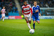 Doncaster Rovers forward Niall Ennis (31) andGillingham FC defender Jack Tucker (27) during the EFL Sky Bet League 1 match between Gillingham and Doncaster Rovers at the MEMS Priestfield Stadium, Gillingham, England on 15 February 2020.