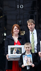 © licensed to London News Pictures. London, UK 27/02/2014. Relatives of Ross and Clare Simons, who were killed when they were knocked off their tandem by a banned driver on January 27, 2013, handing over a petition to No10 Downing Street calling for harsher penalties. Photo credit: Tolga Akmen/LNP
