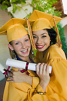 Two graduates hugging outside portrait