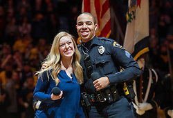 Feb 13, 2016; Morgantown, WV, USA; West Virginia University police officer Carlton Smith and Leslie Dorchester sing the national anthem before the start of the West Virginia and TCU game at the WVU Coliseum. Mandatory Credit: Ben Queen-USA TODAY Sports