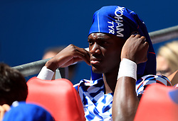 "Chelsea's Tammy Abraham shelters from the sun on the bench during the Community Shield match at Wembley Stadium, London. PRESS ASSOCIATION Photo. Picture date: Sunday August 5, 2018. See PA story SOCCER Community Shield. Photo credit should read: Mike Egerton/PA Wire. RESTRICTIONS: EDITORIAL USE ONLY No use with unauthorised audio, video, data, fixture lists, club/league logos or ""live"" services. Online in-match use limited to 75 images, no video emulation. No use in betting, games or single club/league/player publications."