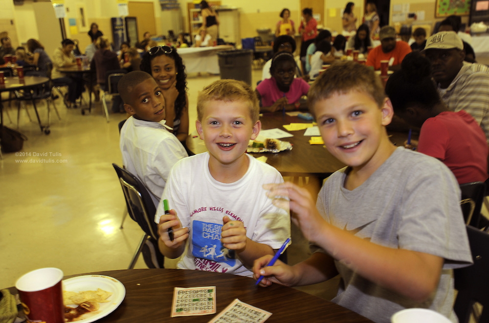 Sagamore Hills Elementary School students, parents and volunteers enjoy a family dinner catered by Moe's Burritos followed by bingo in Atlanta, on Tuesday, Sept. 13, 2011.    (David Tulis/dtulis@gmail.com)