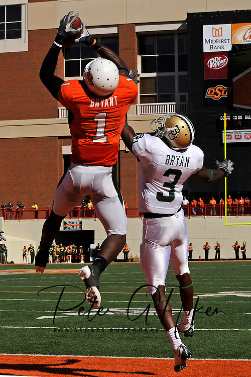 Oct 18, 2008; Stillwater, OK, USA; Oklahoma State Cowboys wide receiver Dez Bryant (1) pulls in a 9-yard touchdown pass over Baylor Bears defensive back Antareis Bryan (3) during the second quarter at Boone Pickens Stadium.