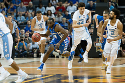 Kentucky guard Dominique Hawkins leads a fast break in the first half. <br /> <br /> The University of Kentucky hosted the University of North Carolina in a 2017 NCAA D1 Men's South Regional Championship, Sunday, March 26, 2017 at FedExForum in Memphis.
