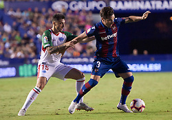 September 30, 2018 - Valencia, U.S. - VALENCIA, SPAIN - SEPTEMBER 30: Ximo Navarro JimŽnez defender of Deportivo Alaves competes for the ball with To–o, defender of Levante UD during the La Liga match between Levante UD and Deportivo Alaves at Estadio Ciutat de Valencia on September 30, 2018, in Valencia, Spain. (Photo by Carlos Sanchez Martinez/Icon Sportswire) (Credit Image: © Carlos Sanchez Martinez/Icon SMI via ZUMA Press)