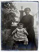mother posing with toddler France 1900s glass plate