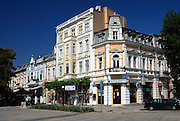 decorative pastel & white buildings; shops; buisnesses; Ruse; Bulgaria; summer