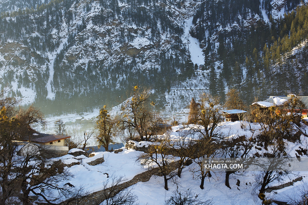 Early morning sunrays on the sheet of white snow covers the Sangla valley.
