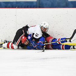 GEORGETOWN, ON - DECEMBER 22: Derek McVey #8 of the Georgetown Raiders collides with Callum Jones #17 of the Oakville Blades in the first period on December 22, 2018 at Gordon Alcott Memorial Arena in Georgetown, Ontario, Canada.<br /> (Photo by Ken Lamb / OJHL Images)