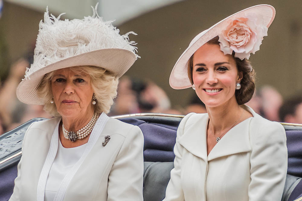 The Duchesses of Cambridge and Cornwall pass down the mall - Queens 90th birthday was celebrated by the tradition Trooping the Colour as well as a flotilla on the river Thames.