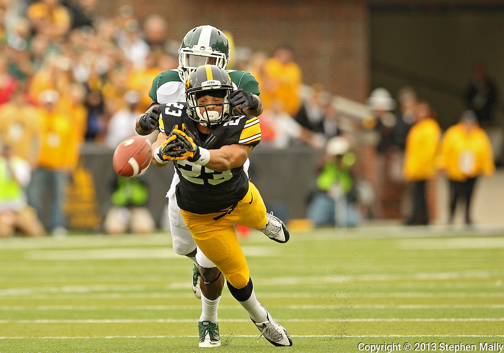 October 6 2013: Iowa Hawkeyes wide receiver Jordan Cotton (23) can't pull in a pass as Michigan State Spartans cornerback Darqueze Dennard (31) defends during the first quarter of the NCAA football game between the Michigan State Spartans and the Iowa Hawkeyes at Kinnick Stadium in Iowa City, Iowa on October 6, 2013.