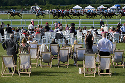 © licensed to London News Pictures. 14/06/2011. Ascot, UK.  Punters watch the 5:00pm race on day one at Royal Ascot races today (14/03/2011). The 5 day showcase event,  one of the highlights of the racing calendar is in it's 300th year. Horse racing has been held at the famous Berkshire course since 1711 and tradition is a hallmark of the meeting. Top hats and tails remain compulsory in parts of the course. Photo credit should read: Ben Cawthra/LNP