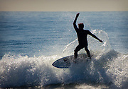 A Man Surfing Waves In Huntington Beach California