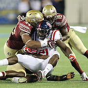 Mississippi Rebels running back Akeem Judd (21) gets tackled by  defensive back A.J. Westbrook (19) defensive end DeMarcus Walker (44) during an NCAA football game between the Ole Miss Rebels and the Florida State Seminoles at Camping World Stadium on September 5, 2016 in Orlando, Florida. (Alex Menendez via AP)