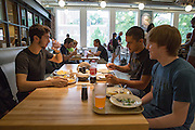 Nick Workman, Cameron Bebb, and Austin Windland finish their lunch at the recently opened Boyd Dinning Hall.