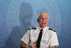 © Licensed to London News Pictures . FILE PICTURE DATED 13/10/2014 of SIR PETER FAHY in Manchester . The Greater Manchester Police Chief Constable has today (9th July 2015) announced he will stand down in October 2015 . Photo credit : Joel Goodman/LNP