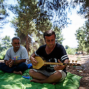 2016 July-Ritsona Refugee Camp, Ritsona, Greece. Adnan, 44, a Kurdish Iraqi refugee performing with his Kurdish Syrian friend, Duju.