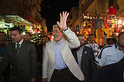 Egyptian Islamist Presidential candidate Abdul Moneim Aboul Fotouh waves to local residents as he campaigns in the market streets of the Bakos neighborhood of Alexandria Egypt April 30, 2012.