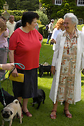 Adelle Nicholson and  Lady Beevor. Pug Dog club Tea party held at Cottesbrook Hall.  ( home of  Mr. and Mrs. Alastair Macdonald-Buchanan ) 26 June 2005. . ONE TIME USE ONLY - DO NOT ARCHIVE  © Copyright Photograph by Dafydd Jones 66 Stockwell Park Rd. London SW9 0DA Tel 020 7733 0108 www.dafjones.com
