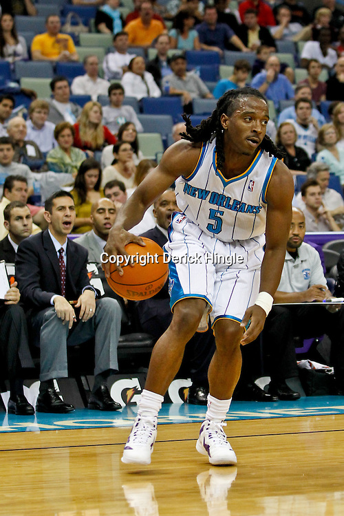 December 21, 2011; New Orleans, LA, USA; New Orleans Hornets guard Carldell Johnson (5) against the Memphis Grizzlies during a preseason game at the New Orleans Arena.   Mandatory Credit: Derick E. Hingle-US PRESSWIRE