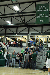 10 January 2015:  the 2013-14 Titans mens basketball team takes to the court with Athletic Director Dennis Bridges to unroll the banner for being semi-finalists in the 2014 NCAA Division III tournament during an NCAA mens division 3 CCIW basketball game between the Carthage Reds and the Illinois Wesleyan Titans in Shirk Center, Bloomington IL