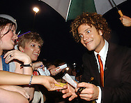 """Justin Guarini, American Idol runner-up and Doylestown native signs autographs for fans at an advance screening of the film """"From Justin to Kelly"""" after being honored at the Regal Warrington Crossing 22 Theater June 13, 2003 in Warrington, Pennsylvania. Guarini stars in the Twentieth Century Fox film along with American Idol Kelly Clarkson. (Photo by William Thomas Cain/photodx.com)"""